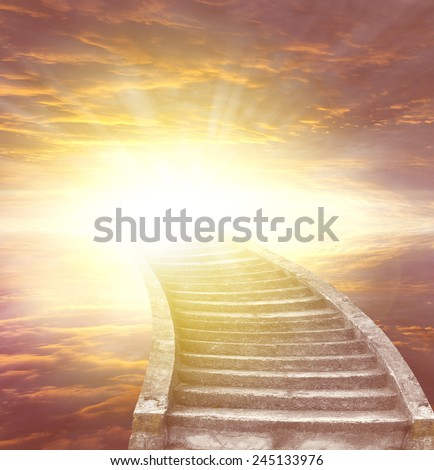 Stairway leading up to bright light  - stock photo