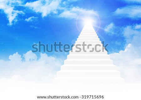 Stairway leading up to bright light above the sky - stock photo