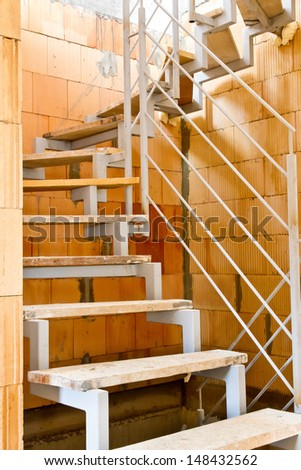 Stairway on a building site - stock photo