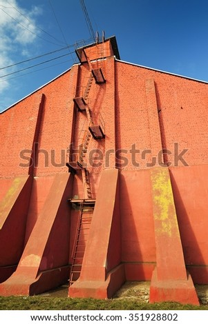 Stairway on red brick wall on clear blue sky vertical - stock photo