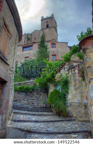 Stairway to the Church in the village of Eus in the Pyrenees - stock photo