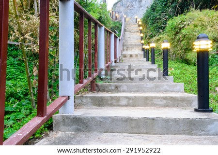 Stairway up the hillside with lamp