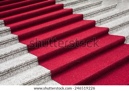 Stairway with the red carpet - stock photo