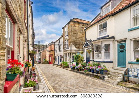 Staithes main street leading to the harbour - stock photo