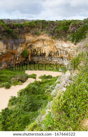 Stalactite and other cave formations hanging from the ceiling, Great Ocean Road, Victoria, Australia. - stock photo