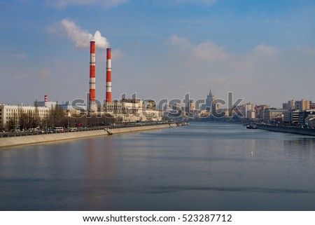 Stalin skyscraper and pipes above Moscow river, Russia
