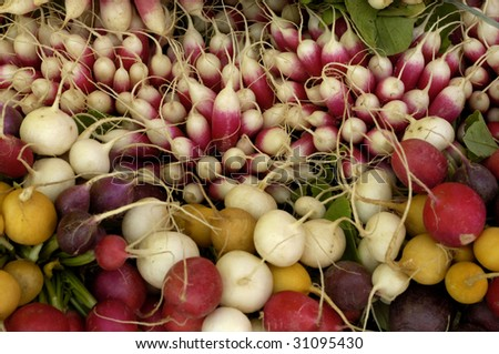 stall of radishes at the market, horizontal picture