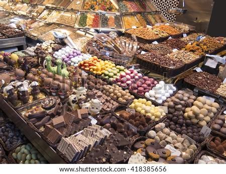 Stall of sweets in La Boqueria - stock photo