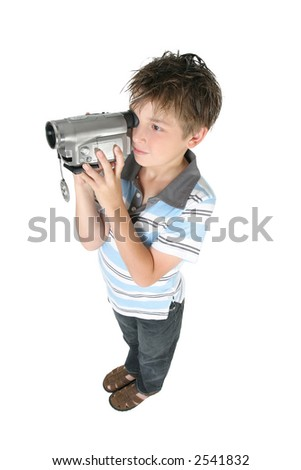 Stamding boy filming with a digital video camera.   White background, - stock photo