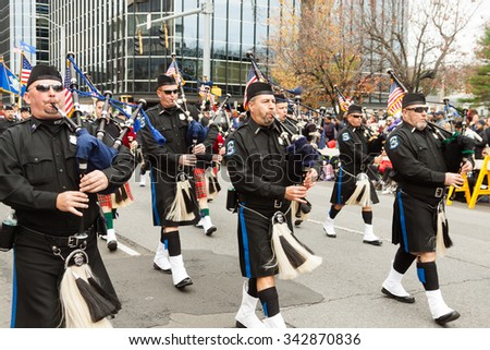 "Stamford, Connecticut - November 22, 2015: The annual ""Thanksgiving Day Parade"" in Stamford, Connecticut on November 22, 2015. The event draws over 100,000 spectators."