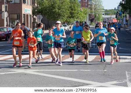 Stamford, CT, USA - June 1, 2014: The individuals are some of the many runners for the cancer awareness marathon in Stamford, CT, June 1, 2014
