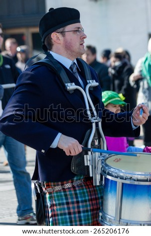 """Stamford, CT, USA - March 7th, 2015: The individual is one of the many participants in the  """"Annual St. Patrick's Day"""" parade held on March 7th, 2015 in downtown Stamford Connecticut.  - stock photo"""