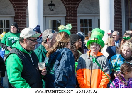 "Stamford, USA - March 7, 2015: The Individuals are some of the many spectatorson who on March 7, 2015, are enjoying the annual ""St. Patrick's Day"" parade in Stamford Connecticut."