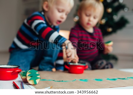 Stamp Christmas tree, children in background - stock photo