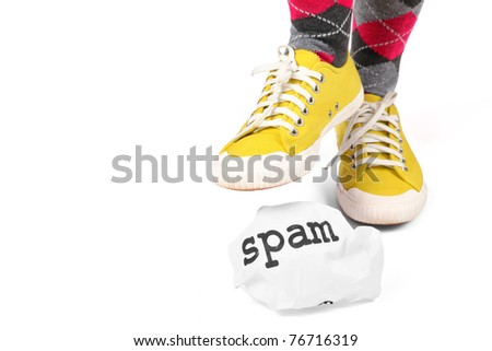 Stamp out spam.  A metaphor for the distaste and elimination of spam be it by spyware or personally. - stock photo