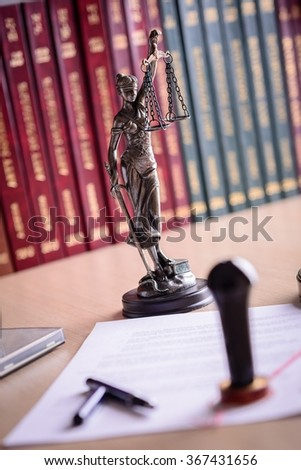 Stamp that is used by a notary public and power of attorney document.  - stock photo