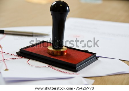 Stamp that is used by a notary public and signed document - stock photo