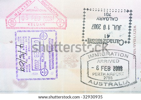 Stamps from Canada, Australia, Malaysia in a Polish passport - stock photo
