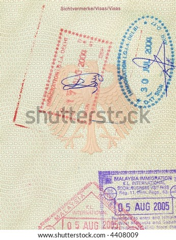 stamps of india and malaysia in german passport - stock photo