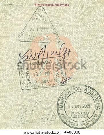 stamps of kenya and australia in german passport - stock photo