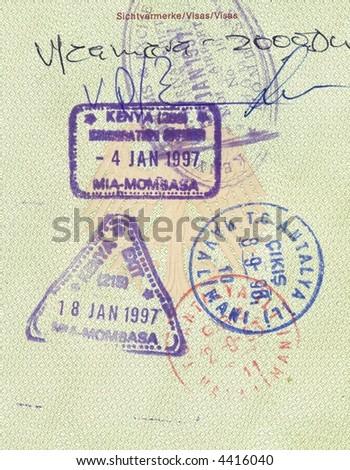 stamps of kenya and turkey in german passport - stock photo