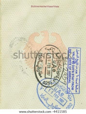 stamps of uae in german passport - stock photo