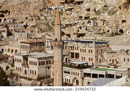 STANBUL, TURKEY - MARCH 04, 2015:Cappadocia, Central Anatolia in Turkey. Desert landscape with ancient rock carved houses in Goreme turkish Kapadokya region in Asia Minor. - stock photo