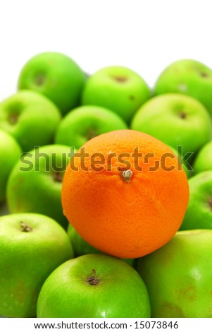 Stand Out From Crowd With Orange and Apples - stock photo