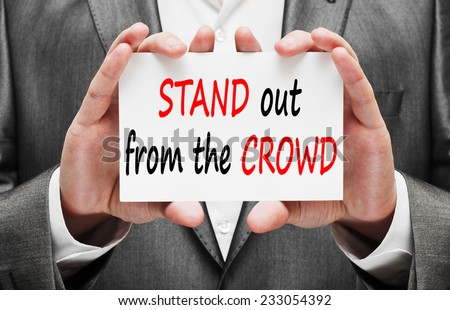 Stand out from the crowd concept in businessman hands - stock photo