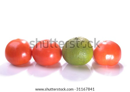 stand out lime in the line up of tomatoes - stock photo