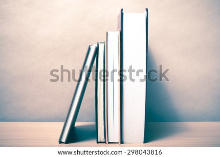 stand up of book on wood table background vintage style