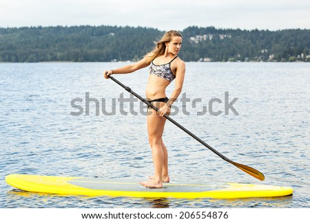 Stand up paddle boarder - stock photo