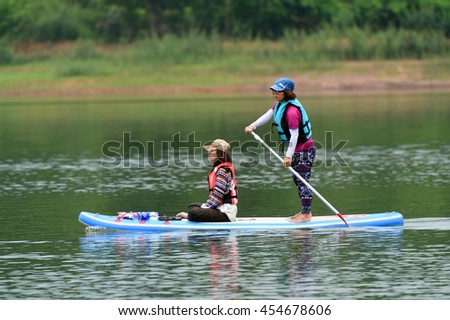 Stand up paddle boards (SUP) offer a fun, relaxing way to play on the water, Cam Son Lake, Bac Giang, Viet Nam 2016