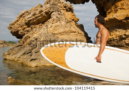 Stand Up Paddle Surf in mediterranean sea (Majorca) in summer