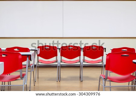 standard classroom interior with red chair - stock photo