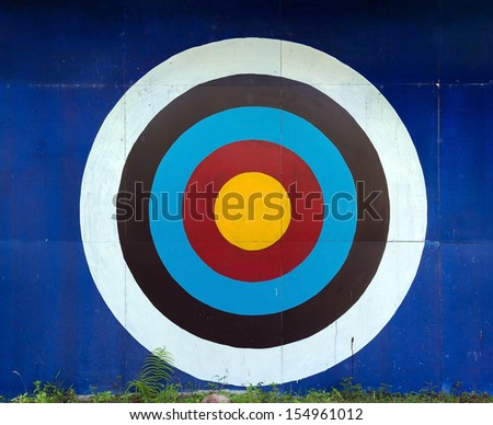 Standard target of different colors for decoration on the old wall  - stock photo