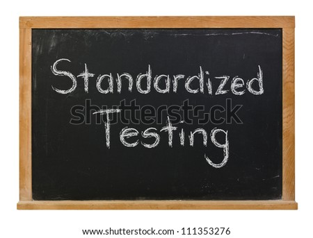 Standardized Testing written in white chalk on a black chalkboard - stock photo