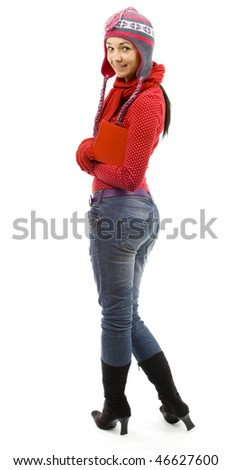 standing adult girl from crossed arms in winter cap and mittens - stock photo