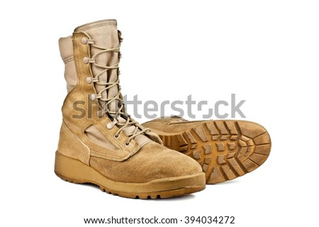 standing and lying army boots isolated on white background - stock photo