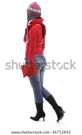 standing backwards young woman in winter clothes with red book - stock photo