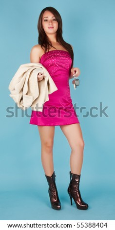 Standing beautiful girl with fur coat and car key - stock photo