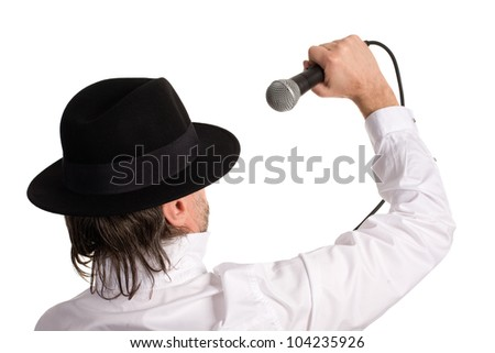 Standing behind a singer with a microphone. - stock photo