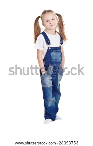 Standing blonde little girl with ponytails wearing blue overalls