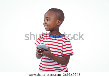 Standing boy holding smartphone on white screen