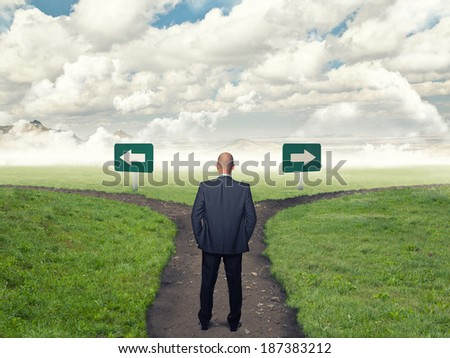 standing business man and crossroad - stock photo