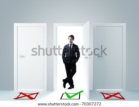 standing businessman and 3d door with checkmark - stock photo