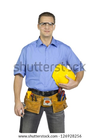 Standing construction worker holding a hard hat - stock photo