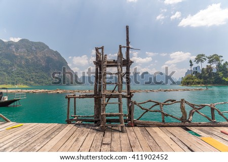standing driving board post in lake and mountain at khao sok national park