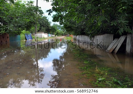 Standing flood waters over roads and fields