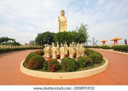 Standing Golden Buddha Statues - stock photo